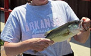 Jennifer Jones catches fish in Lake Hamilton