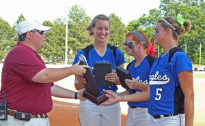 Karisa Hendrix, Felicia Woodard, and Kacey Rasnic accept 4th place trophy for Williams Baptist College Lady Eagles