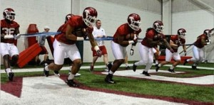 Alex Collins and teammates during spring practice 2014