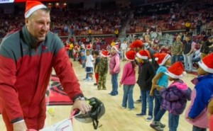 Bielema hands out bikes during halftime of Razorback basketball